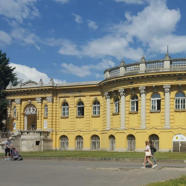 Yellow exterior of Szechenyi Spa Baths in Budapest, Hungary