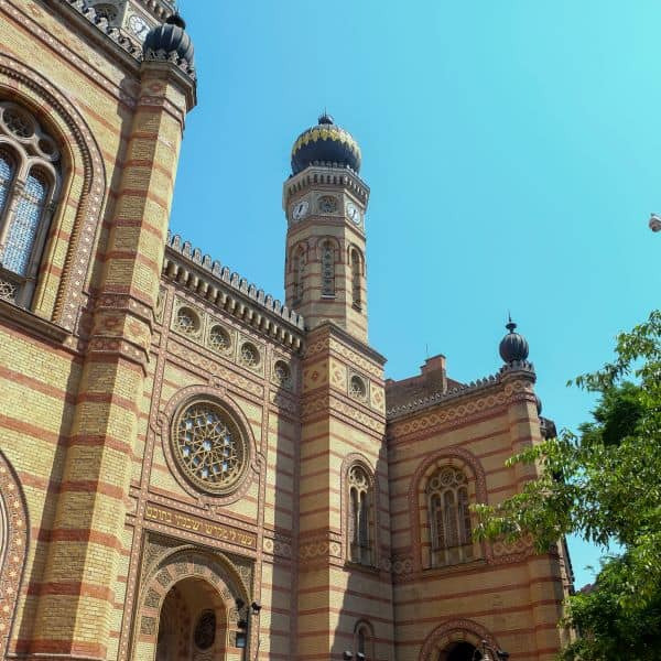 Exterior of the Great Synagogue in Budapest, Hungary with onion dome, rosette, Moorish Revival, red and yellow brick