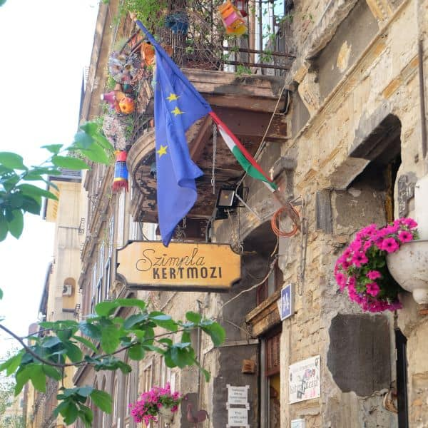 Exterior of Szimpla Kert ruin pub and sign in Budapest Hungary