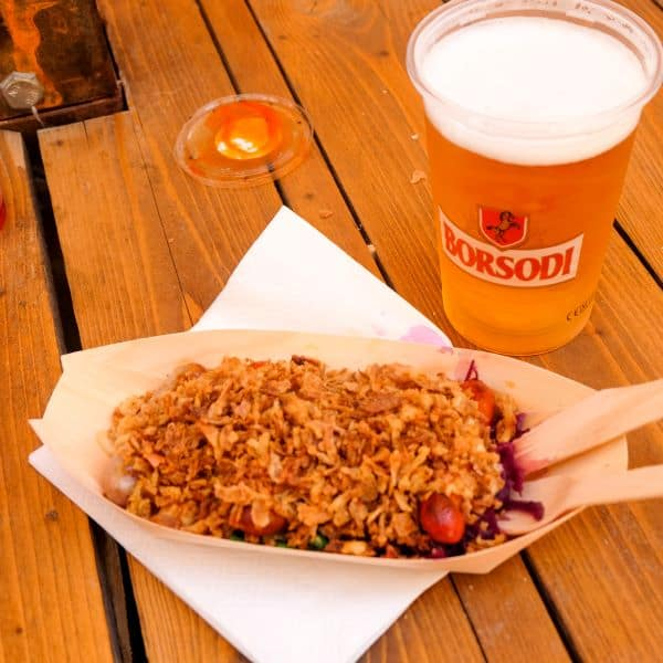 Sausage and beer from Karavan food truck food court in Budapest, Hungary