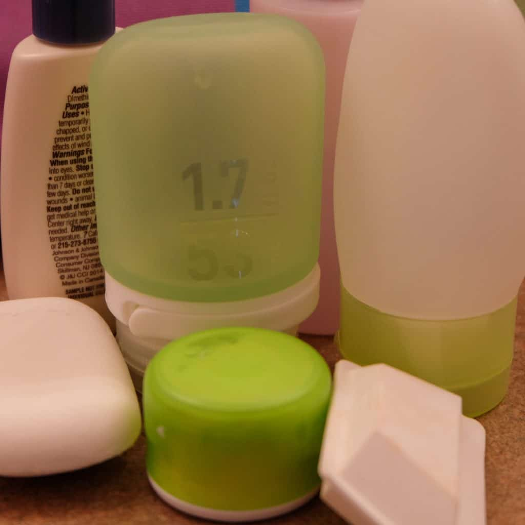 a variety of travel-sized containers for toiletries