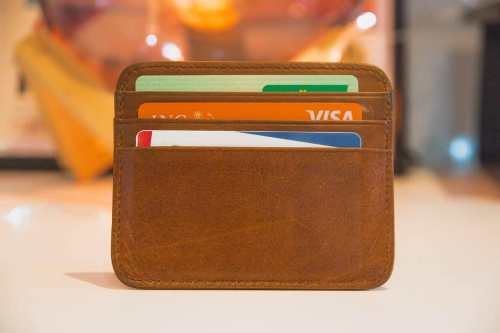 small brown wallet with credit cards