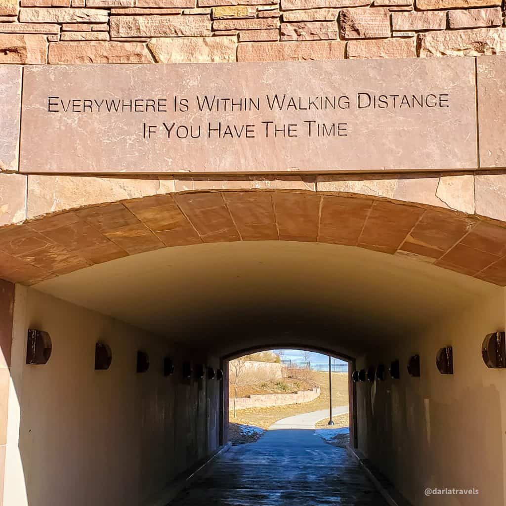 """underpass in Lone Tree, Colorado with sign """"Everywhere is within Walking Distance if you have the time"""""""