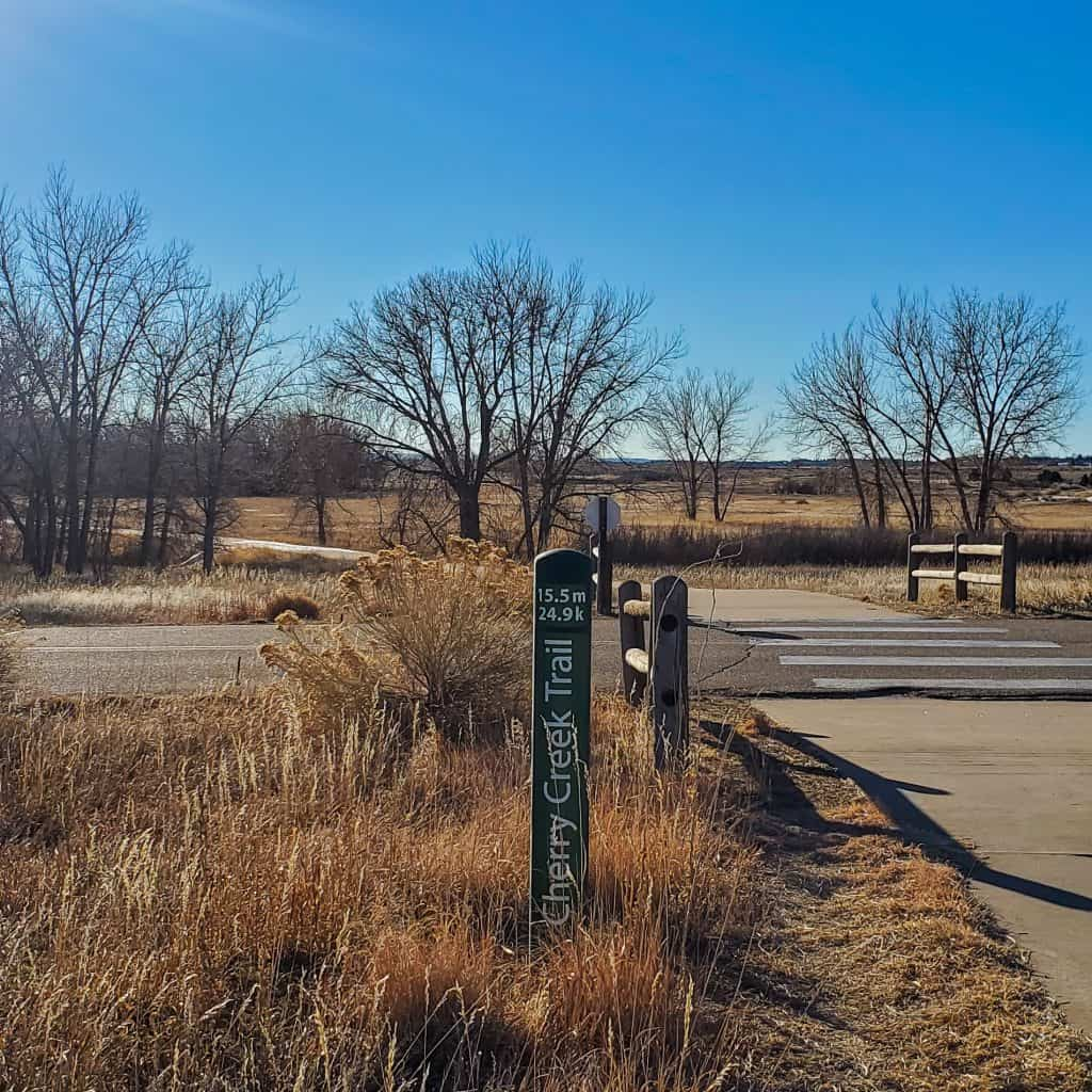 12.5 m 24.9 km green mile marker for the Cherry Creek trail in Cherry Creek State Park