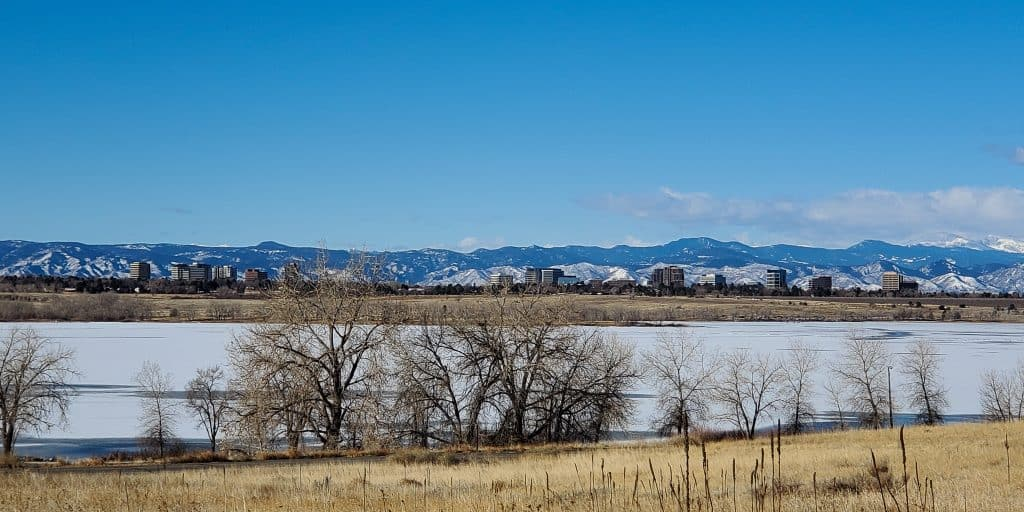 Looking across the reservoir at Cherry Creek State Park from the Smoky Hill Trail; frozen reservoir, Rocky Mountians