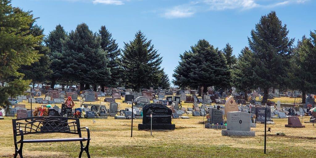 Littleton Cemetery, bench gravestones, large trees