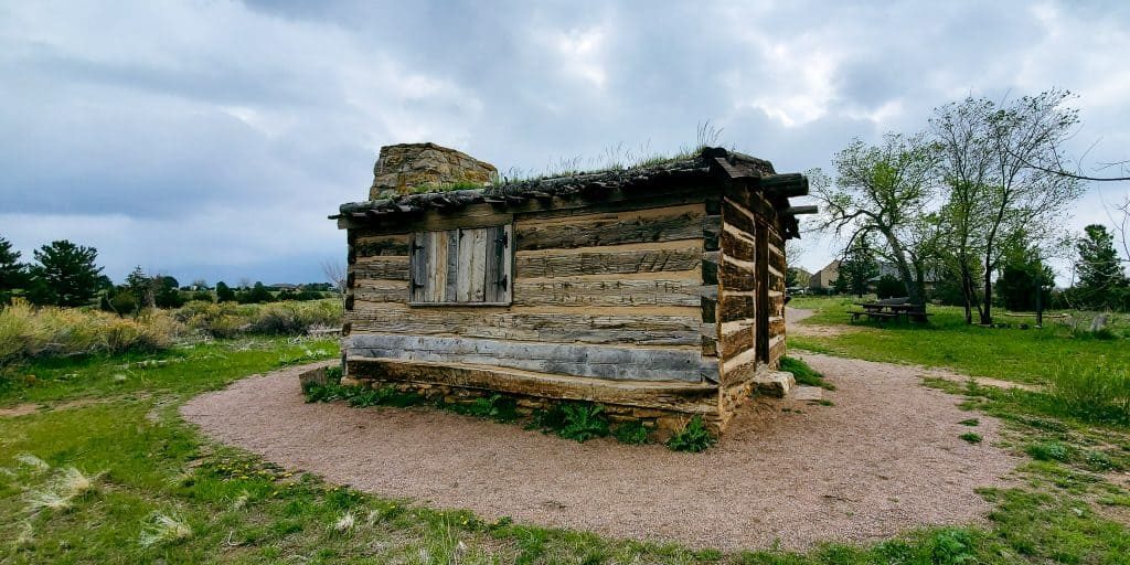 pioneer cabin; Slocum cabin in Chatfield State Park; cloudy sky
