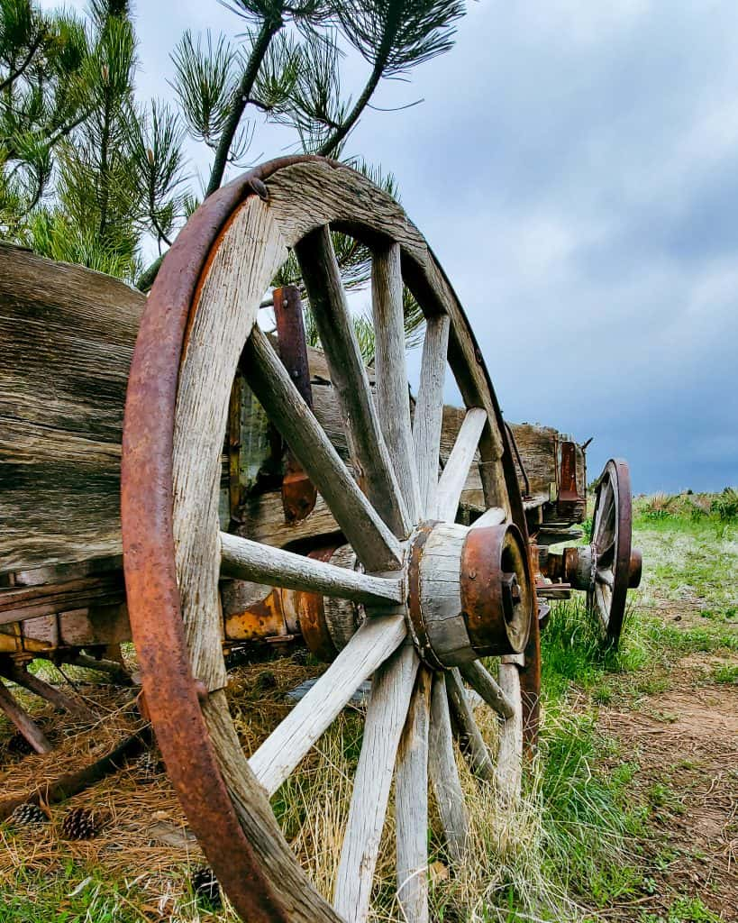 Pioneer wagon near the Slocum cabin in Chatfield State Park; cloudy sky