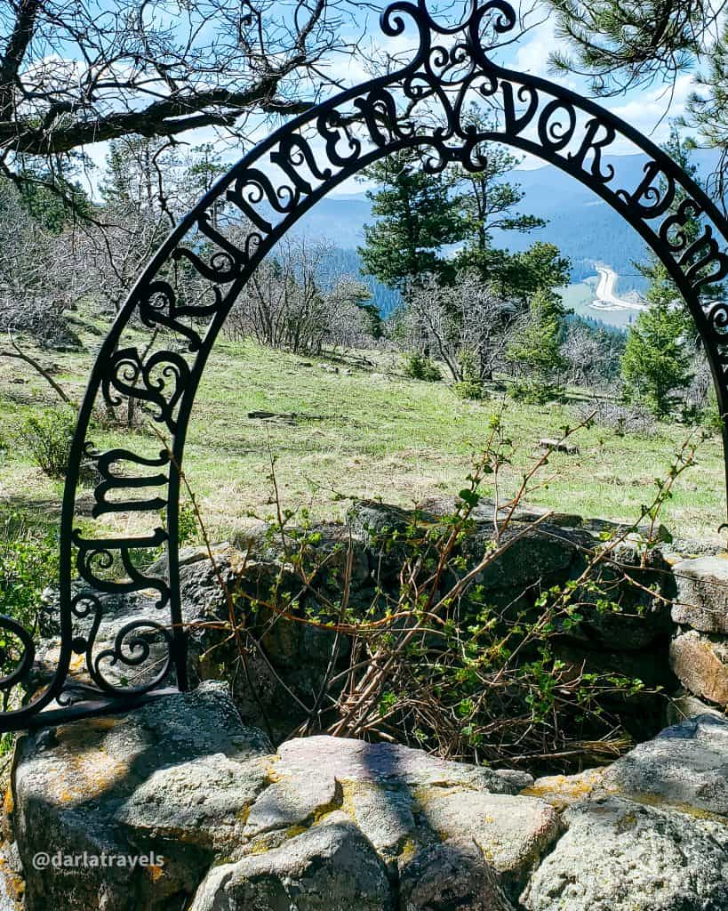 """""""By the well outside the gate"""", near the Eagle's Eye Shelter, site of the former summer cabin of the Frank Kirchhof family.  In Mount Falcon Park, Jefferson County, Colorado"""