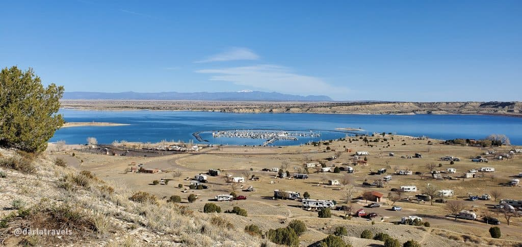 View of Arkansas Point Campground, Lake Pueblo, and Pikes Peak from the Arkansas Point Trail in Lake Pueblo State Park