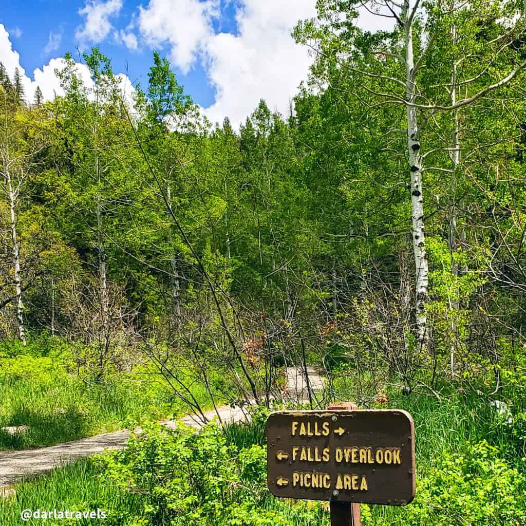 Trailhead at Fish Creek Falls, Routt county, Steamboat Springs, Colorado.  283-foot waterfall i n Routt National Forest. Directional Sign