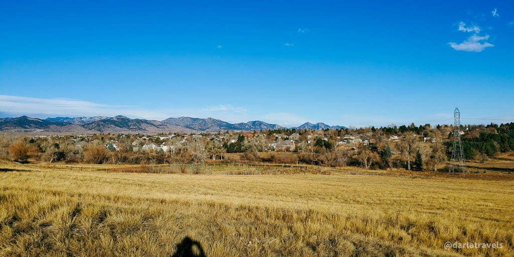View from the south border of Van Bibber Park on the Outer Loop Trail. View of park, residential area and mountains. In Jefferson County, Colorado