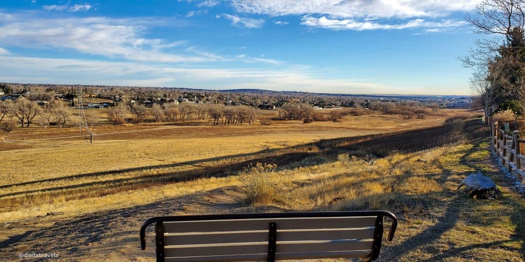 View from the south border of Van Bibber Park on the Outer Loop Trail. View of bench, park, residential area and Denver metro area.  In Jefferson County, Colorado