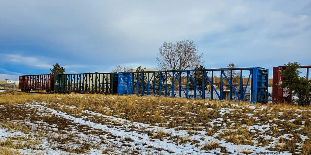 Rail cars visible from the Sand Creek Regional Greenway near Star K Ranch