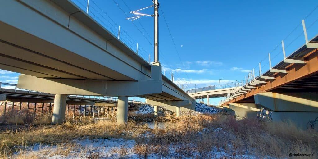 Train tracks and roads over  the Sand Creek Regional Greenway Trail, near Central Park Blvd, Denver, Colorado