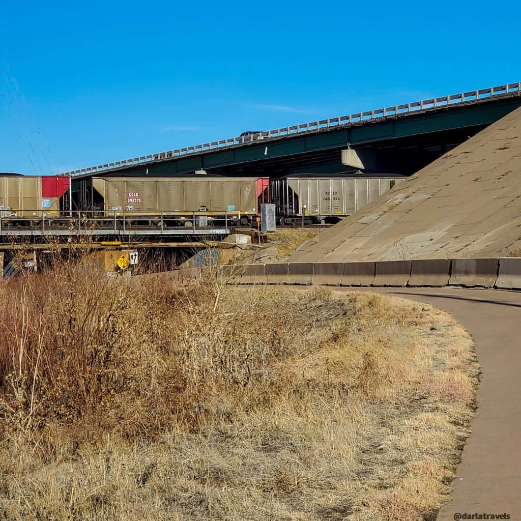 Trail moving under train tracks and highway in Commerce City, Colorado