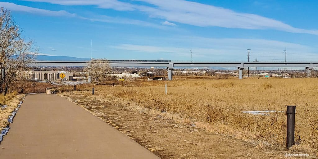 The Sand Creek Regional Greenway Trail crosses under commuter rail lines in Commerce City, Colorado